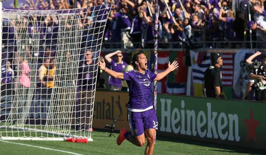 Orlando City SC player Adrian Winter (32) celebrates after he scored the game-tying goal in extra time during an MLS soccer game against Real Salt Lake in Orlando, Fla., Sunday, March 6, 2016. The game ended in a 2-2 tie. (Stephen M. Dowell/Orlando Sentinel via AP) MANDATORY CREDIT