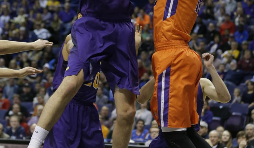 Northern Iowa's Bennett Koch (25) and Evansville's Mislav Brzoja (10) battle for possesion during the first half of an NCAA college basketball game in the championship of the Missouri Valley Conference men's tournament, Sunday, March 6, 2016, in St. Louis. (AP Photo/Tom Gannam)