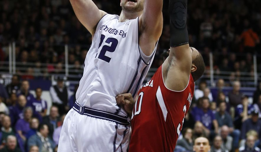 Northwestern center Alex Olah, left, goes to the basket against Nebraska forward Ed Morrow, right, during the second half of an NCAA college basketball game Sunday, March 6, 2016, in Evanston, Ill. Northwestern won 65-54. (AP Photo/Kamil Krzaczynski)