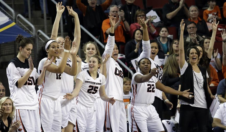 Players on the Oregon State bench celebrate a score against UCLA in the first half of an NCAA college basketball game in the championship game of the Pac-12 Conference tournament, Sunday, March 6, 2016, in Seattle. (AP Photo/Elaine Thompson)