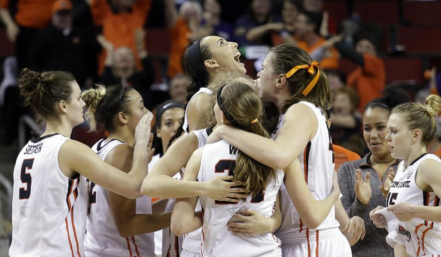 Oregon State players huddle and cheer after defeating Washington in an NCAA college basketball game in the Pac-12 Conference tournament Saturday, March 5, 2016, in Seattle. Oregon State won 57-55. (AP Photo/Elaine Thompson)