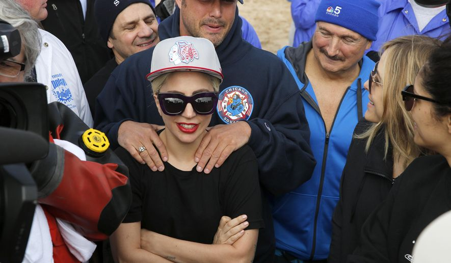 "Lady Gaga, center, and her fiance ""Chicago Fire"" actor Taylor Kinney talk with the cast of the show and stars from other television shows before Chicago's Polar Plunge on Sunday, March 6, 2016, at North Avenue Beach in Chicago. Gaga and Al Roker were among the celebrities jumping into frigid Lake Michigan waters at the fundraiser for the Special Olympics. (Michael Tercha/Chicago Tribune via AP) MANDATORY CREDIT CHICAGO TRIBUNE; CHICAGO SUN-TIMES OUT; DAILY HERALD OUT; NORTHWEST HERALD OUT; THE HERALD-NEWS OUT; DAILY CHRONICLE OUT; THE TIMES OF NORTHWEST INDIANA OUT; TV OUT; MAGS OUT; NO SALES"