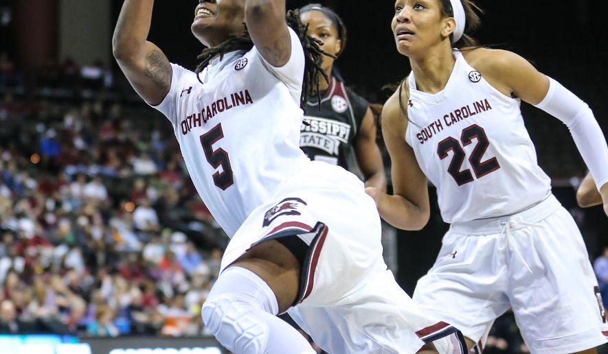 South Carolina guard Khadijah Sessions (5) shoots the ball in front of teammate A'ja Wilson (22) against Mississippi State during NCAA college basketball action in the Southeastern Conference women's tournament final in Jacksonville, Fla., Sunday, March 6, 2016. (AP Photo/Gary McCullough)