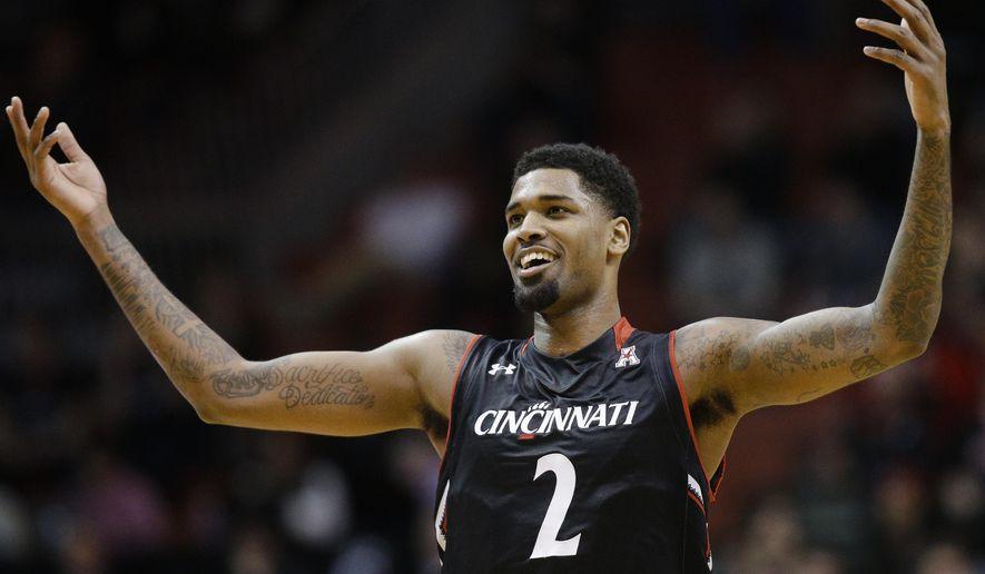 Cincinnati's Octavius Ellis (2) celebrates after scoring during the first half of an NCAA college basketball game against SMU, Sunday, March 6, 2016, in Cincinnati. (AP Photo/John Minchillo)