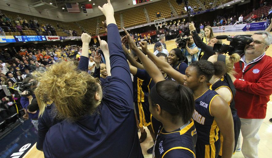 Chattanooga celebrates after Chattanooga's 65-57 victory over Mercer in the championship game of the NCAA women's Southern Conference basketball tournament in Asheville, N.C., Sunday, March 6, 2016. (AP Photo/Ben Earp)