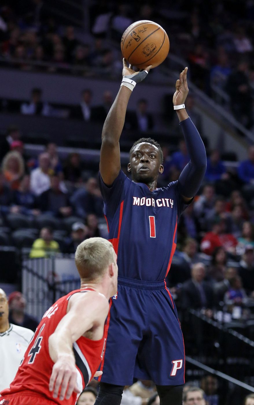 Detroit Pistons' Reggie Jackson (1) takes a shot against Portland Trail Blazers' Mason Plumlee during the first half of an NBA basketball game on Sunday, March 6, 2016, in Auburn Hills, Mich. (AP Photo/Duane Burleson)