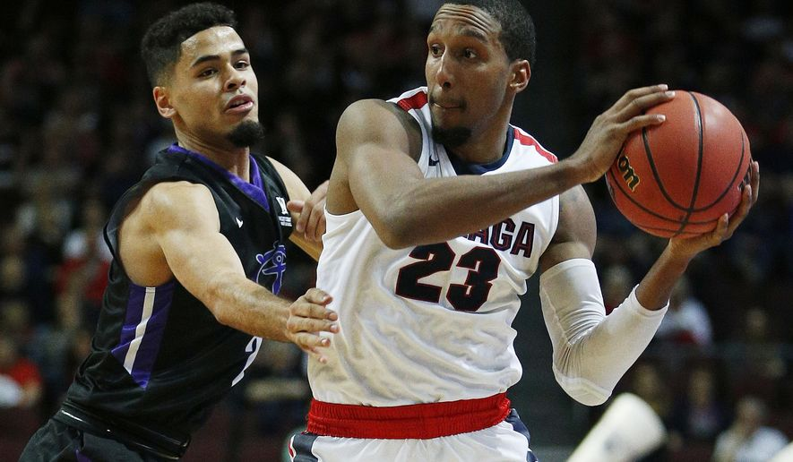 Portland guard Alec Wintering, left, guards Gonzaga guard Eric McClellan during the first half of a West Coast Conference tournament NCAA college basketball game Saturday, March 5, 2016, in Las Vegas. (AP Photo/John Locher)