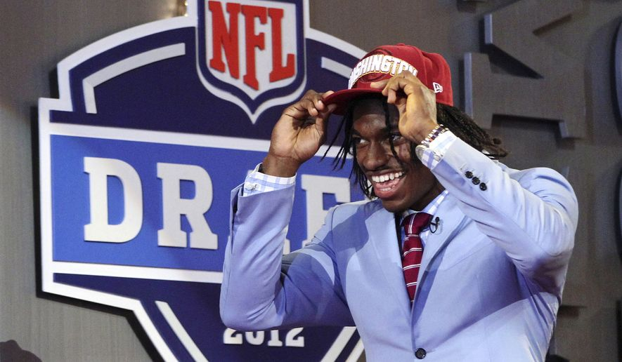 Baylor quarterback Robert Griffin III walks on stage after he was selected as the second pick overall by the Washington Redskins in the first round of the NFL football draft at Radio City Music Hall, Thursday, April 26, 2012, in New York. (AP Photo/Mary Altaffer) ** FILE **