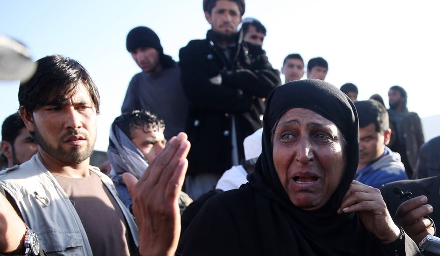 An Afghan female witness talks to the media at the site of a suicide attack near the Defense Ministry compound in Kabul on Feb. 27. The Afghan Taliban say they will not participate in a peace process with Kabul's government until foreign forces in Afghanistan stop attacking their positions and leave the country. (Associated Press)