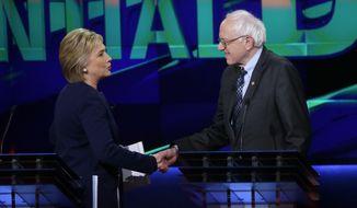 Democratic presidential candidates Hillary Clinton and Bernard Sanders debated Sunday in Flint, Michigan. (Associated Press)