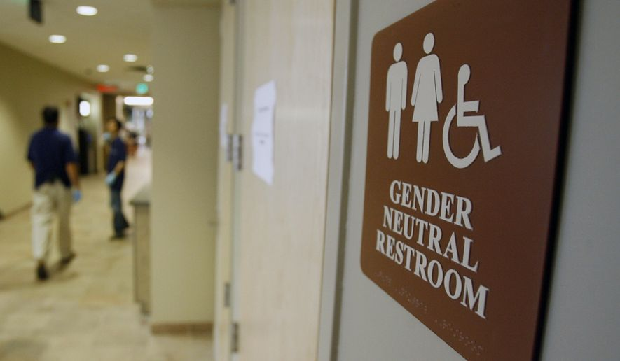 FILE- In this Aug. 23, 2007, file photo, a sign marks the entrance to a gender-neutral restroom at the University of Vermont in Burlington, Vt. (AP Photo/Toby Talbot, File)