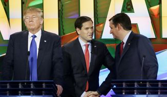 FILE - In this Feb. 25, 2016 file photo, Republican presidential candidate Donald Trump, left, waits as fellow GOP presidential candidates Sen. Marco Rubio, R-Fla., center, and Sen. Ted Cruz, R-Texas, talk during a break in the Republican presidential primary debate at the University of Houston in Houston. Nancy Reagan spent decades protecting the legacy of her husband, but some of President Ronald Reagan's famous political advice appears lost among the White House candidates who embrace him as a guiding light. (AP Photo/David J. Phillip, File)