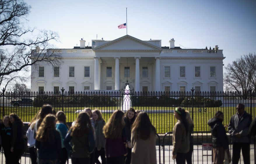 The American flag is lowered to half-staff above the White House to mark the death of former first lady Nancy Reagan. (Associated Press)