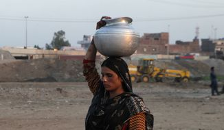 A Pakistani woman fetches clean water for her family in Lahore, Pakistan, Monday, March 7, 2016. (AP Photo/K.M. Chaudary) ** FILE **