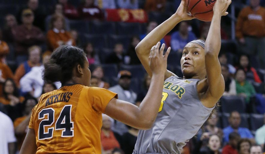 Baylor forward Nina Davis, right, shoots in front of Texas guard Ariel Atkins (24) in the first quarter of an NCAA college basketball championship game in the Big 12 women's tournament in Oklahoma City, Monday, March 7, 2016. (AP Photo/Sue Ogrocki)