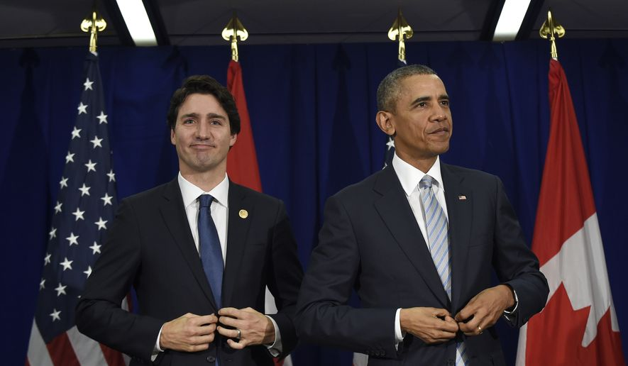 Prime Minister Justin Trudeau, left, stand up following their bilateral meeting at the Asia-Pacific Economic Cooperation summit in Manila, Philippines, Thursday, Nov. 19, 2015. (AP Photo/Susan Walsh) ** FILE **