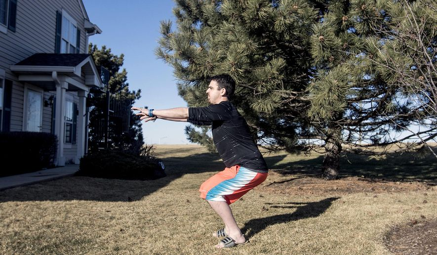 In this Feb. 20, 2016 photo, Chris Pry exercises while training at his home in Crustal Lake, Ill. Pry, 35, had a double lung transplant in Sept. 2014 after suffering from cystic fibrosis. His younger brother, Michael, also went the transplant process in 2010 but didn't survive. (Sarah Nader/Northwest Herald via AP) CHICAGO TRIBUNE OUT, MANDATORY CREDIT