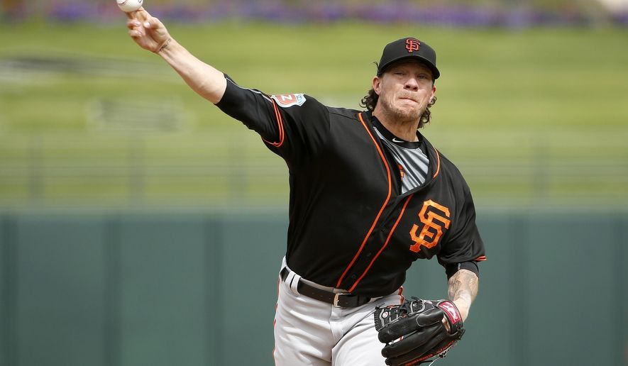 San Francisco Giants' Jake Peavy pitches against the Texas Rangers during the second inning of a spring training baseball game Monday, March 7, 2016, in Surprise, Ariz. (AP Photo/Ross D. Franklin)