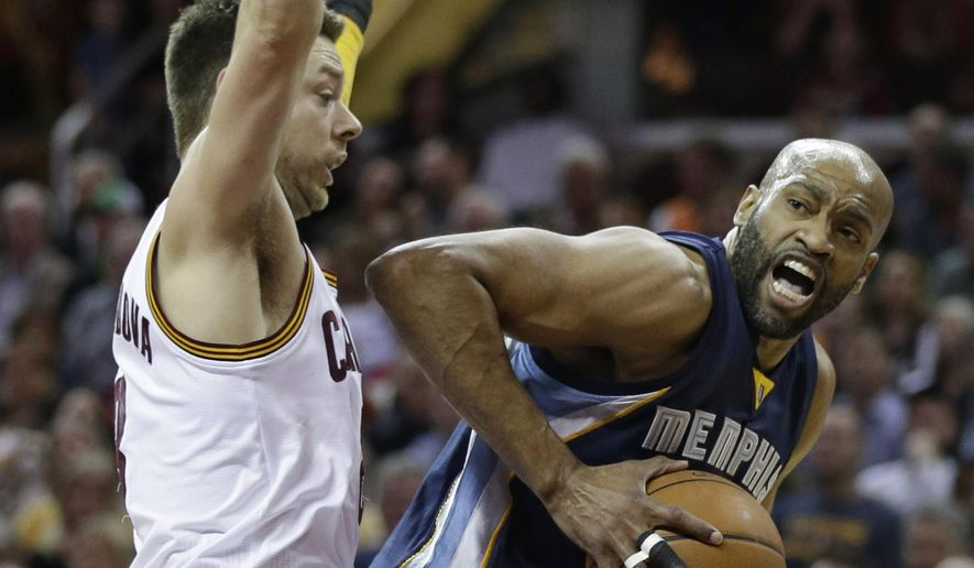 Memphis Grizzlies' Vince Carter (15) tries to get past Cleveland Cavaliers' Matthew Dellavedova (8), from Australia, in the first half of an NBA basketball game Monday, March 7, 2016, in Cleveland. (AP Photo/Tony Dejak)
