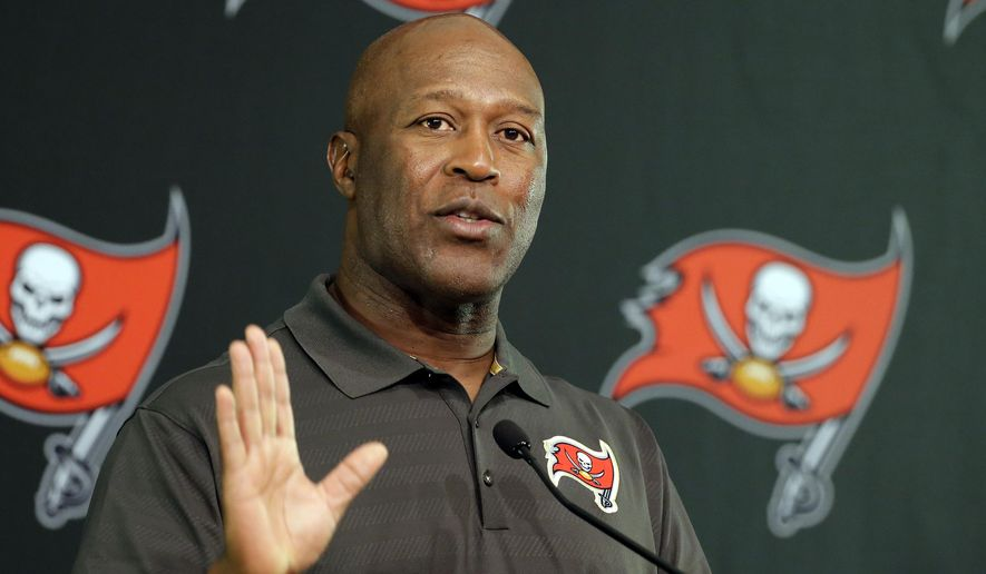 FILE - In this Jan. 4, 2016 file photo, Tampa Bay Buccaneers head coach Lovie Smith speaks at a news conference in Tampa, Fla. The University of Illinois said Monday, March 7, 2016, that Smith will be named the next football coach at the University of Illinois. He will replace Bill Cubit who was fired Saturday after one season in charge at Illinois. (AP Photo/Chris O'Meara, File)