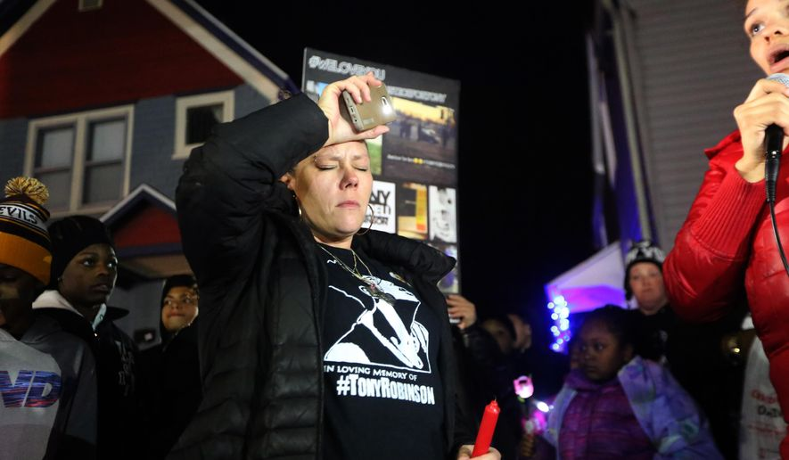 Andrea Irwin participates in a candlelight vigil marking the one year anniversary of the police shooting death of her son Tony Robinson on Sunday, March 6, 2016, in Madison, Wis. Community members planned a series of events over the weekend to mark the one-year anniversary of Robinson, who was unarmed when fatally shot by a white police officer on March 6, 2015. They say they hope the events draw attention to the lack of tangible difference in the city's policing. (John Hart/Wisconsin State Journal via AP) MANDATORY CREDIT