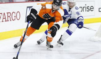 Philadelphia Flyers' Shayne Gostisbehere (53) skates with the puck as Tampa Bay Lightning's Steven Stamkos (91) gives chase during the first period of an NHL hockey game, Monday, March 7, 2016, in Philadelphia. (AP Photo/Chris Szagola)