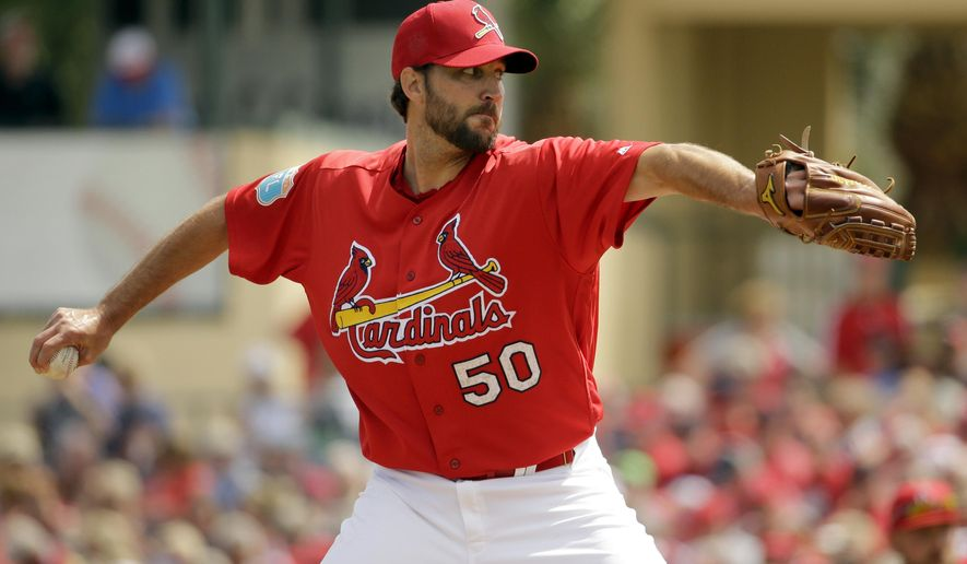 St. Louis Cardinals starting pitcher Adam Wainwright throws during the first inning of an exhibition spring training baseball game against the New York Mets, Monday, March 7, 2016, in Jupiter, Fla. (AP Photo/Jeff Roberson)