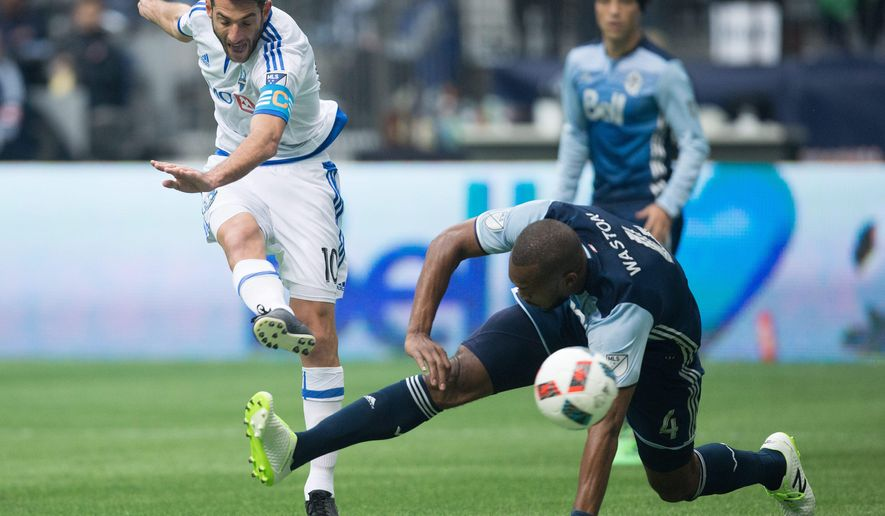Montreal Impact's Ignacio Piatti, left, of Argentina, scores a goal as Vancouver Whitecaps' Kendall Waston, of Costa Rica, defends during first half MLS soccer action, in Vancouver, British Columbia, on Sunday, March 6, 2016. (Darryl Dyck/The Canadian Press via AP)