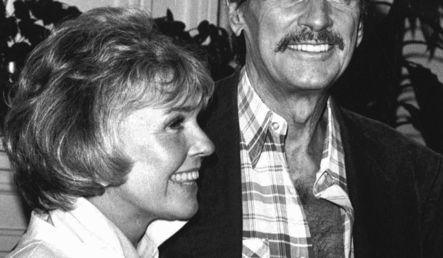 FILE - In this July 18,1985, file photo, Doris Day and Rock Hudson speak at a news conference in Monterey, Calif. In 2011, PBS aired a documentary that addressed Nancy Reagan's role in the AIDS crisis. Among those interviewed was historian Allida Black, who said Mrs. Reagan's friendship with two AIDS victims, movie star Hudson and prominent attorney Roy Cohn, prompted her to encourage her husband to seek more funding for AIDS research. (AP Photo/Chris Hunter, File)
