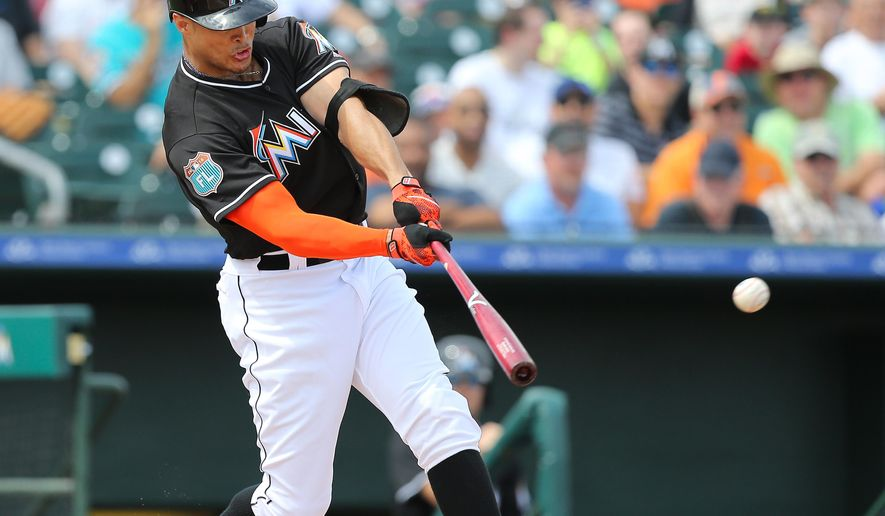 Miami Marlins right fielder Giancarlo Stanton flies out during the second inning of a spring training baseball game against the Washington Nationals Friday, March 4, 2016, at Roger Dean Stadium in Jupiter, Fla. (David Santiago/El Nuevo Herald via AP)  MAGS OUT; MANDATORY CREDIT