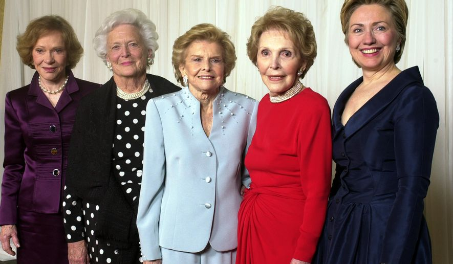 "FILE - In this Jan. 17, 2003 file photo, former first ladies get together for a group photo at a gala 20th anniversary fundraising event saluting Betty Ford and the Betty Ford Center in Indian Wells, Calif. From left are Rosalynn Carter, Barbara Bush, Betty Ford, Nancy Reagan and Sen. Hillary Rodham Clinton. As now-retired AP reporter Jeff Wilson recalls, Mrs. Reagan would occasionally let down her guard. Reagan, Carter, Bush and Ford all waited impatiently, for hours, the arrival of then-U.S. Sen. Hillary Clinton, who was late because of an important floor vote in Washington. Growing more impatient, finally she looked at me and tersely said: ""I'm starving."" I offered to get her something but she demurred. (AP Photo/Reed Saxon, File)"