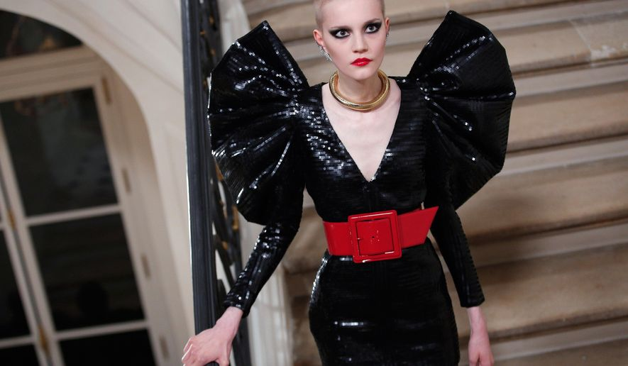 A model wears a creation for Yves Saint Laurent's Fall-Winter 2016-2017 ready to wear fashion collection presented Monday, March 7, 2016 in Paris. (AP Photo/Thibault Camus)