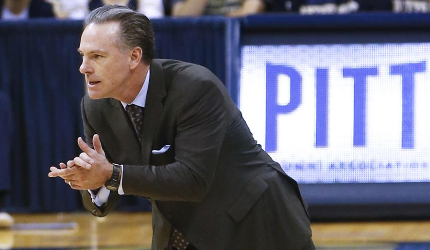 FILE - In this file photo from Dec. 23, 2015, Pittsburgh head coach Jamie Dixon works with his team during an NCAA college basketball game against Western Carolina, in Pittsburgh. The Panthers (20-10, 9-9 ACC) enter the ACC Tournament on a two-game skid and in danger of missing out on the NCAA tournament for a second straight year. (AP Photo/Keith Srakocic, File)