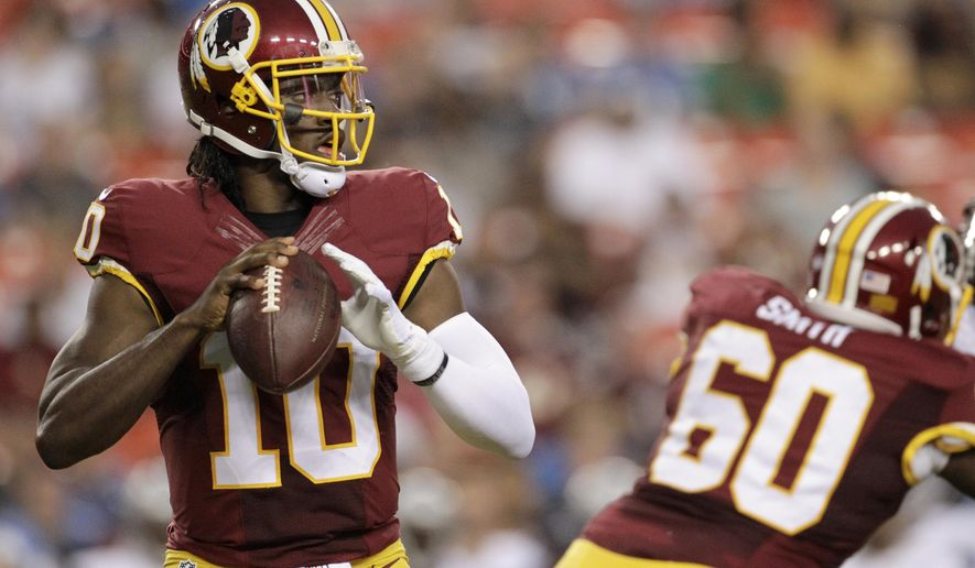 """In this photo taken Aug. 20, 2015, Washington Redskins quarterback Robert Griffin III (10) passes the ball during the first half of an NFL preseason football game against the Detroit Lions in Landover, Md. Griffin has tweeted what sounded a lot like a goodbye to fans of the Redskins. Griffin wrote Monday: """"It was a blessing guys. I just want to say thank you."""" (AP Photo/Mark Tenally)"""