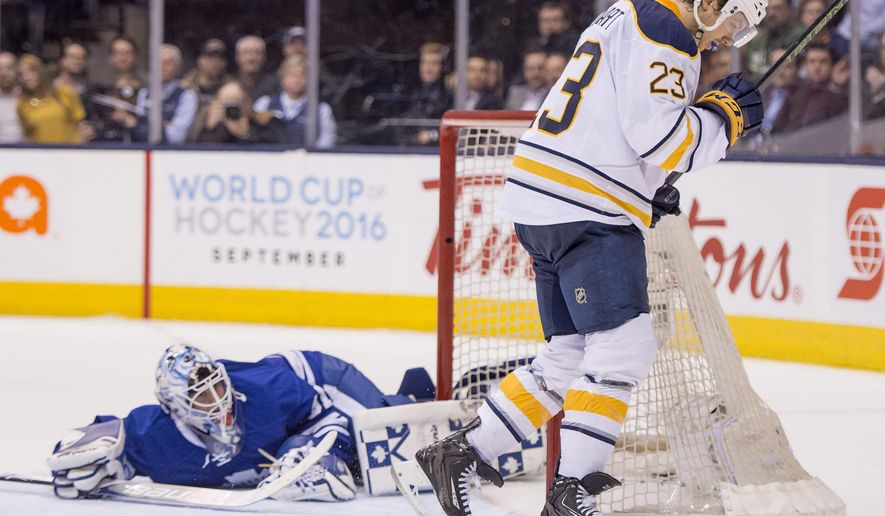 Buffalo Sabres' centre Sam Reinhart (23) celebrates his game winning over time shootout goal on Toronto Maple Leafs goaltender Garret Sparks in NHL action in Toronto on Monday, March 7, 2016. THE CANADIAN PRESS/Frank Gunn