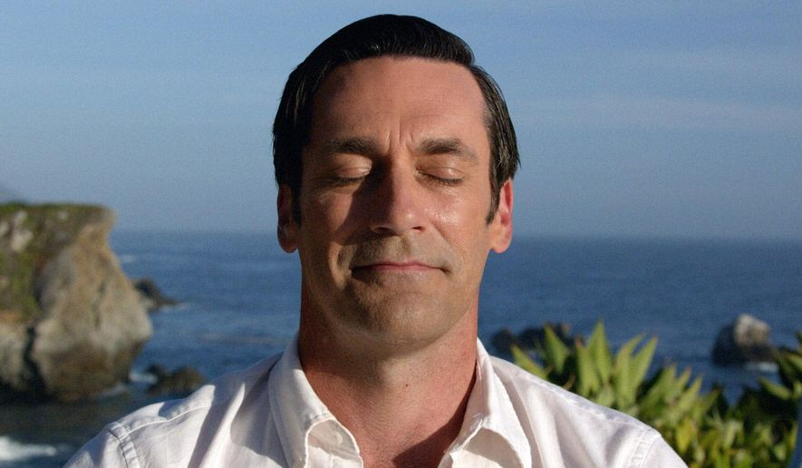"""This image released by AMC shows Jon Hamm as Don Draper in a scene from the final episode of """"Mad Men."""" Seemingly a broken man, Don Draper got his groove back while meditating at a yoga camp. In the finale, he linked Coca-Cola with world peace in a warm-and-fuzzy TV commercial. The idea brought Don back to the big time, demonstrating he was truly The Real Thing. (AMC via AP)"""
