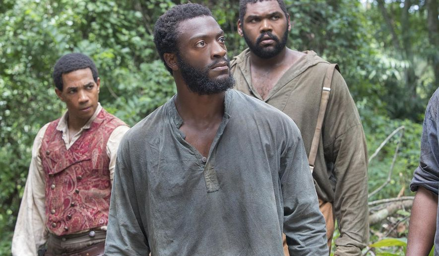 "This image released by WGN shows, from left, Alano Miller, Aldis Hodge and Theodus Crane in a scene from ""Underground,"" a new drama series premiering on WGN America on Wednesday at 10 p.m. EDT.  (Skip Bolen/Sony Pictures Television via AP)"