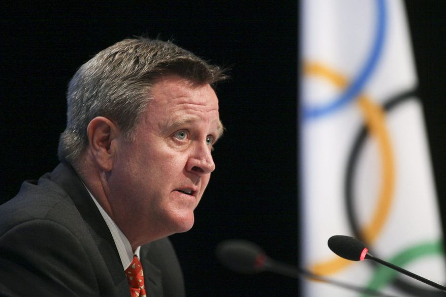 FILE - In this May 24, 2012, file photo, Scott Blackmun discusses an agreement between the International Olympic Committee and the U.S. Olympic Committee at the SportAccord conference in Quebec City. Once they get to the Olympics in Rio de Janeiro, American athletes could be faced with virus-spreading mosquitoes, virus-infested water and the prospect of competing against at least two countries, Russia and Kenya, that are under investigation for top-to-bottom doping conspiracies. (Francis Vachon/The Canadian Press via AP, File)
