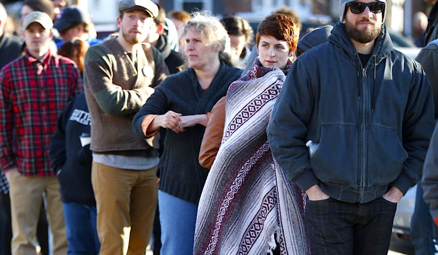 Democratic primary voters line up outside a polling place in Portland, Maine. (AP Photo/Robert F. Bukaty) ** FILE **