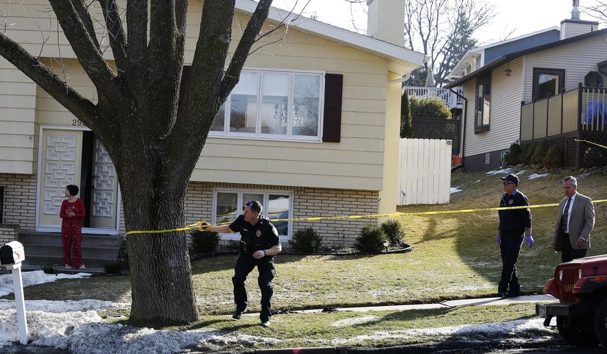 Rochester police officers investigate the scene of a shooting in Rochester, Minn., Monday, March 7, 2016. Rochester police say a woman is critically wounded and a man dead after a domestic dispute. (Andrew Link/The Rochester Post-Bulletin via AP) MANDATORY CREDIT