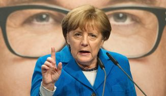 German Chancellor Angela Merkel refuses to limit the number of refugees her country will allow, causing a shake-up in her party. (Associated Press)