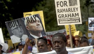 """FILE - In this June 17, 2012 file photo, Frank Graham, center right, father of teenager Ramarley Graham, who was shot by police, participates in a silent march to end Stop-and-Frisk policy in New York. Graham was shot and killed after police chased him into his home in the Bronx during a narcotics investigation.  On Tuesday, March 8, 2016, federal prosecutors in Manhattan said they will not bring charges in the Graham case because they determined """"there is insufficient evidence to meet the high burden of proof required for a federal criminal civil rights prosecution."""" (AP Photo/Seth Wenig, File)"""