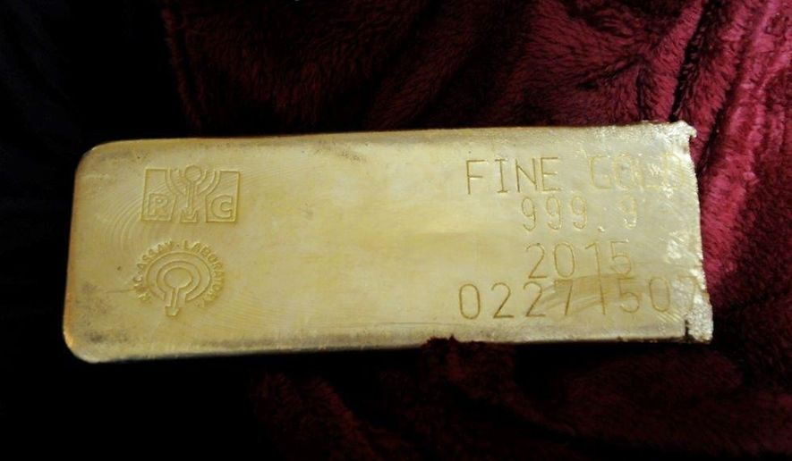 This undated file photo provided by the FBI shows a gold bar that was recovered in Miami from a heist in North Carolina on March 1, 2015. (FBI via AP, File)
