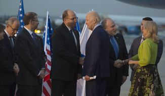 U.S. Vice President Joe Biden shakes hands with Israel Defense Minister Moshe Ya'alon, left, fter arriving at Ben Gurion Airport in Lod, Israel on Tuesday, March 8, 2016. (Heidi Levine/Pool photo via AP)