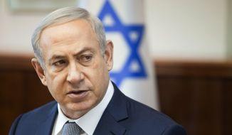 In this Sunday, Feb. 14, 2016, file photo, Israeli Prime Minister Benjamin Netanyahu speaks during the weekly cabinet meeting in Jerusalem. (AP Photo/Dan Balilty, File)