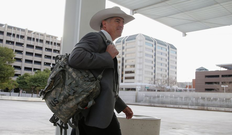 Texas Ranger Nick Hanna, who was involved in the case against Warren Jeffs on the Fundamentalist Church of Jesus Christ of Latter Day Saints sect compound near San Angelo, Texas, in 2008, arrives at the Sandra Day O'Connor U.S. District Court, in this Jan. 28, 2016, file photo. Two polygamous towns on the Utah-Arizona border violated the constitutional rights of nonbelievers by denying them basic services such as police protection, building permits and water hookups, a jury said Monday, March 7, 2016. (AP Photo/Ross D. Franklin, File)