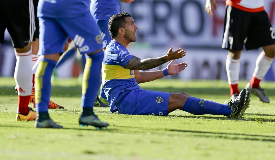 Carlos Tevez, of Boca Juniors, reacts during a local tournament soccer match against  River Plate in Buenos Aires, Argentina, Sunday, March 6, 2016. (AP Photo/Natacha Pisarenko)
