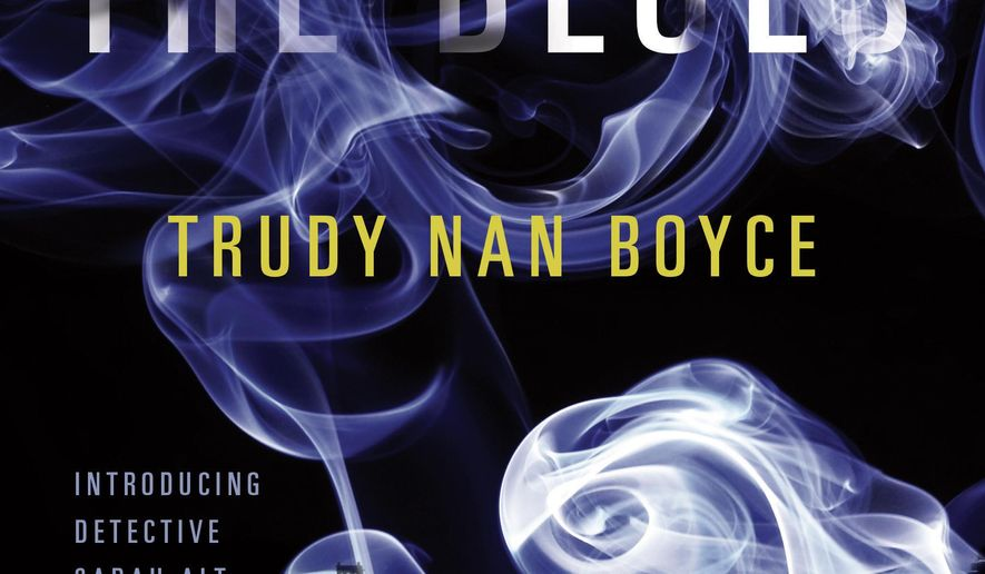 """This book cover image released by Putnam shows, """"Out of the Blues,"""" by Trudy Nan Boyce. Boyce, a retired Atlanta Police Department officer, is currently working on a new book about the murder of students at Spelman College, a prominent black liberal arts school in Atlanta, and the protests that follow when the suspects are not identified. She says the currently untitled novel was inspired in part by the shooting of Michael Brown in Ferguson, Missouri. (Putnam via AP)"""