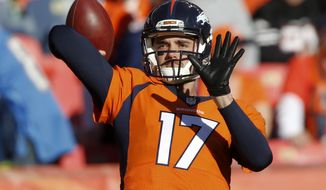 FILE - In this Jan. 3, 2016, file photo, Denver Broncos quarterback Brock Osweiler warms up before an NFL football game against the San Diego Chargers in Denver. Now that the Broncos have bid farewell to quarterback Peyton Manning, who retired on Monday, March 7, the team is hoping that Osweiler will take up the reins of the Super Bowl champion's offense. (AP Photo/David Zalubowski, File)