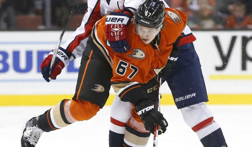 Anaheim Ducks center Rickard Rakell (67) collides with Washington Capitals' Mike Richards in the first period of an NHL hockey game in Anaheim, Calif., Monday, March 7, 2016. (AP Photo/Christine Cotter)
